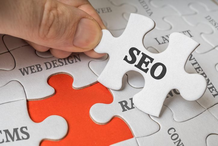 SEO (Search engine optimization) concept. Man is solving puzzle.